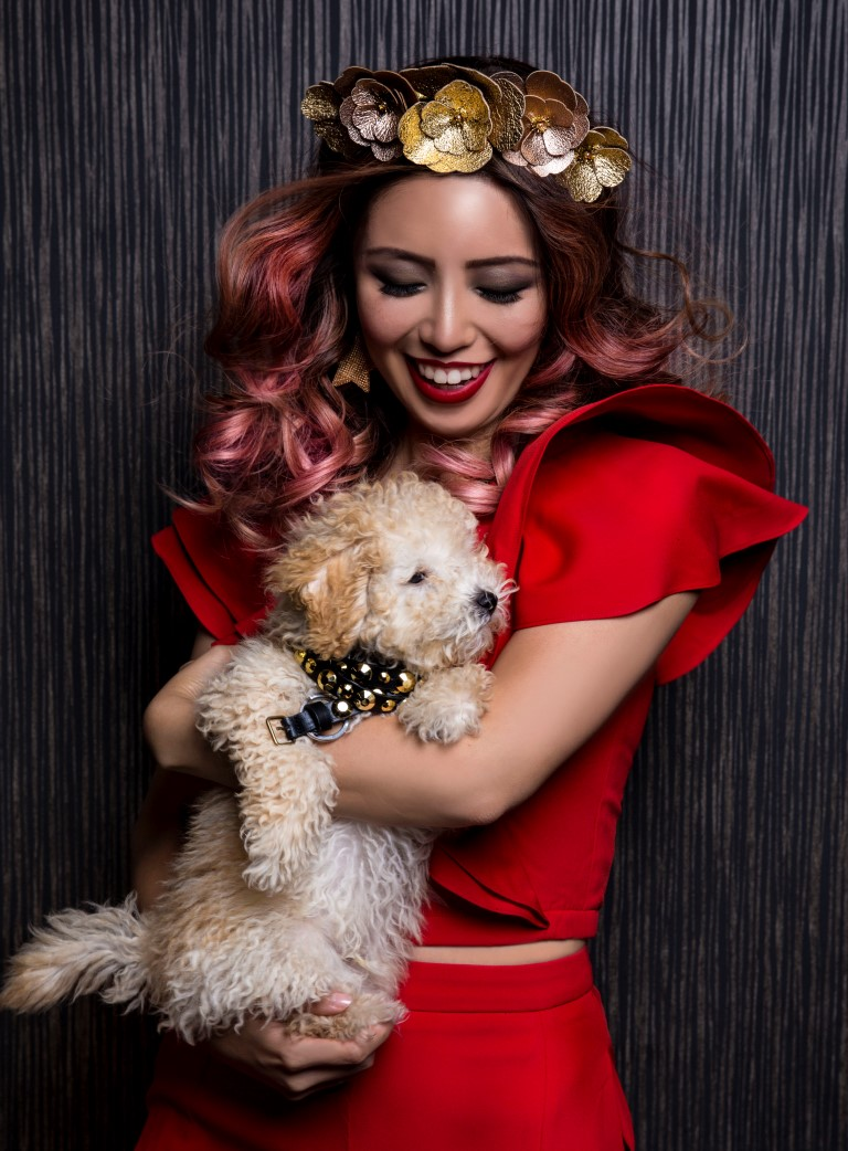 Influencer Connie Cao with Kaz a toy poodle at Rakis on Collins hair salon Melbourne