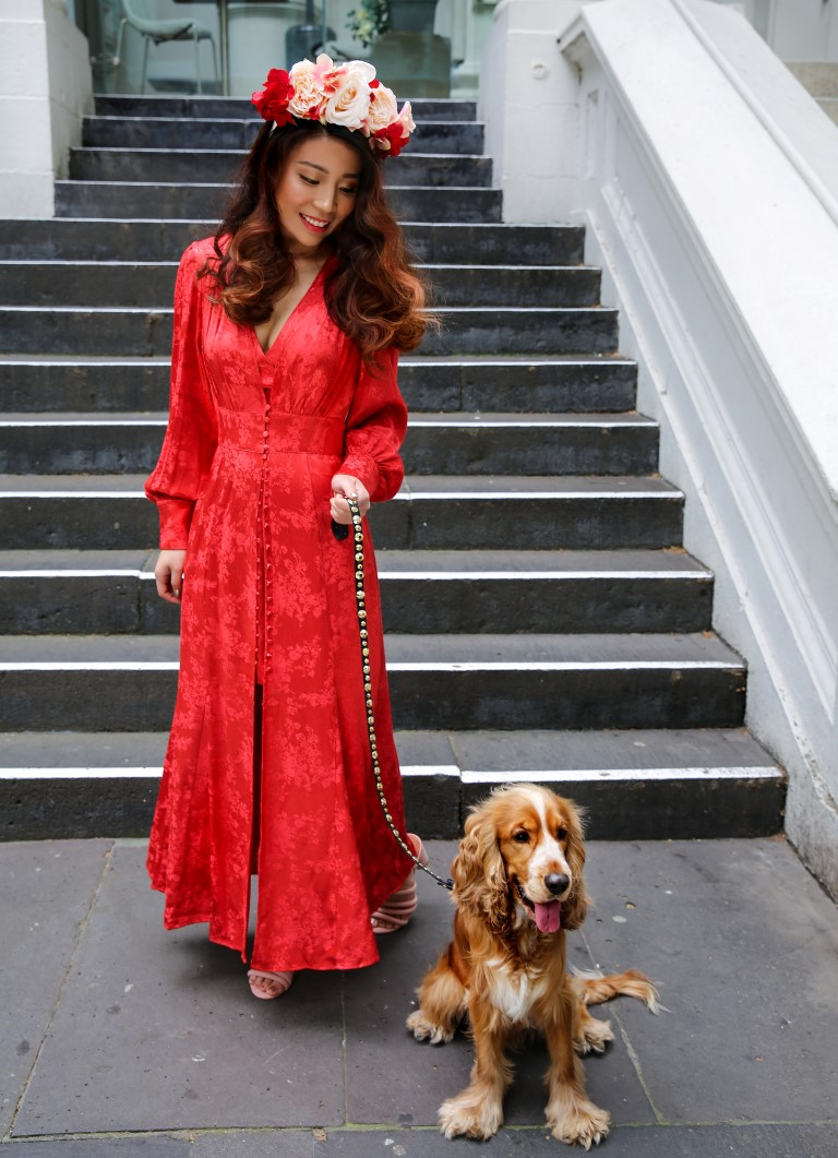 Beauty influencer Hannie Choi with Barry the cocker spaniel outside Rakis on Collins hair salon Melbourne